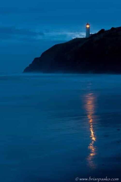 Photograph of the Cape Disappointment Lightouse at twighlight on the Oregon Coast.