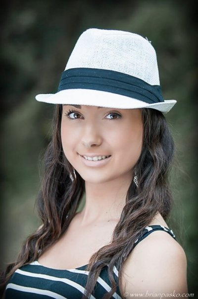 Portrait of a Reynolds High School senior girl wearing a fedora with picture in Columbia River Gorge.