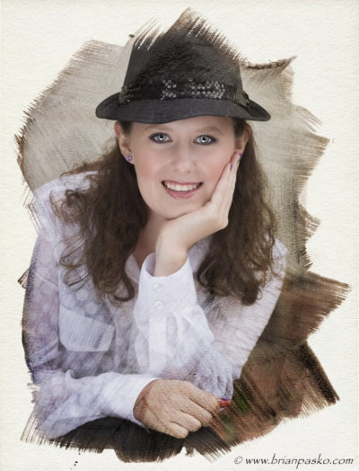 Artistic portrait of a Cleveland High School senior girl wearing a black Fedora.