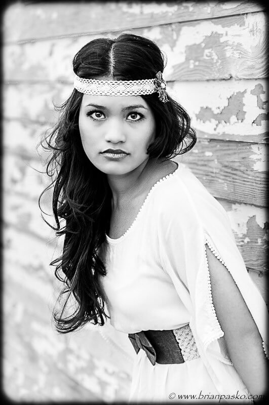 Fashion picture of beautiful high school senior girl portrait in black and white.