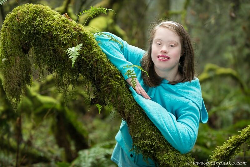 Special Needs Estacada high school senior girl portrait picture in moss and forest.