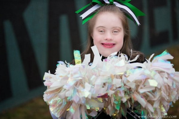 Portrait of a beautiful Estacada High School senior with special needs picture with pompoms at school stadium.
