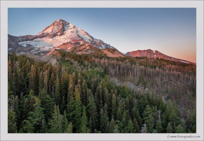 Morning sunrise on Mount Hood and forests below from Cloud Cap Inn, Oregon.