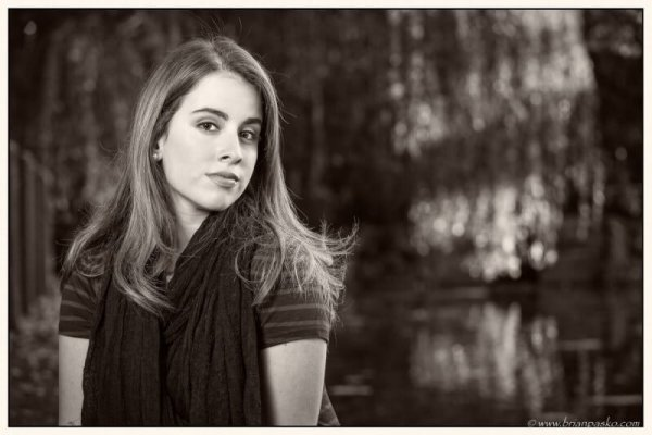 High School senior portrait of girl by lake at sunset picture at Portland park in black and white.