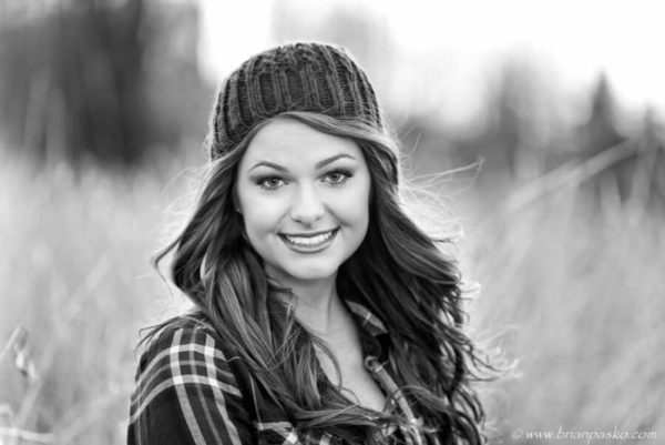 Black and white picture of a high school senior girl in winter.