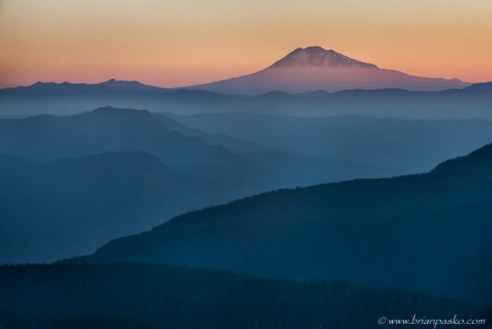 View of Mount Adams from Larch Mountain through layers of Cloud in the Columbia River Gorge, Oregon.