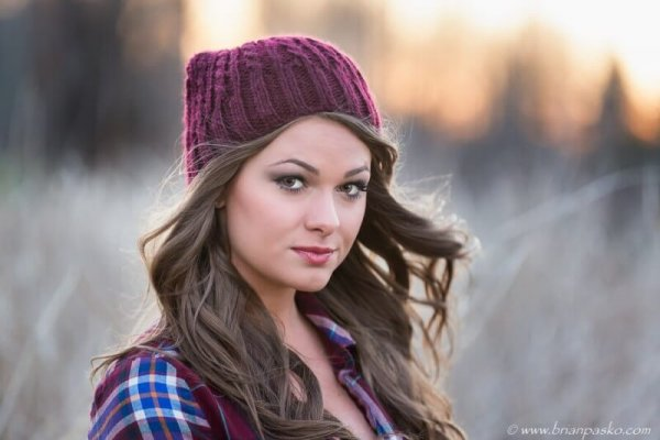 Picture of a high school senior portrait with winter hat picture taken at sunset.