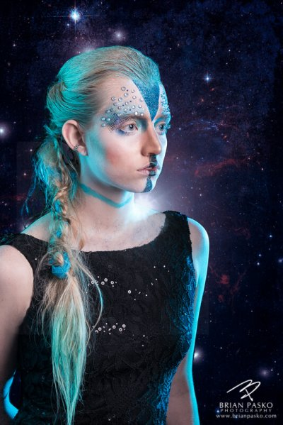 Fashion portrait of a model in professional makeup picture with star wars theme taken in studio by senior picture and family portrait photographer.