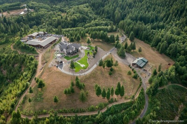 Aerial view from helicopter of private estate and wedding reception in Sandy, Oregon.