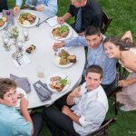 Aerial view of guests at an outdoor wedding reception in Sandy Oregon.