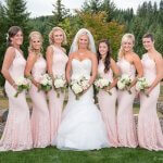 Portrait of a beautiful bride and bridesmaids picture in pink dresses and bouqets at wedding in Sandy Oregon.