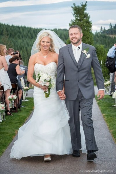 Portrait of beautiful bride and groom exiting their outdoor wedding cermony in Sandy, Oregon.