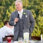 Picture of the father of the bride toasting the wedding couple at an outdoor reception in Sandy Oregon.