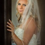 Portrait of a beautiful bride pausing in doorway getting ready for wedding in Sandy Oregon.