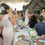 Picture of bridesmaid seeing to bride at an outdoor wedding reception in Sandy Oregon.