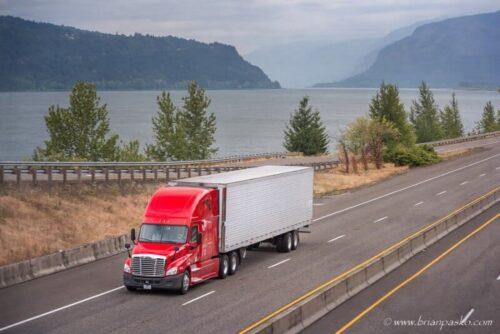 Commercial stiock image of semi truck driving through the Columbia River Gorge, Oregon.