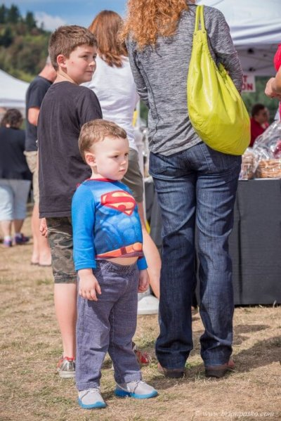 Editorial event photograph of small boy in a Superman costume picture at Celebration in Boring, Oregon.