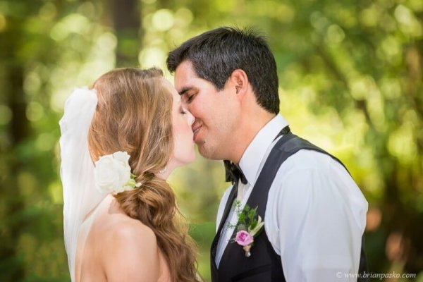 Portrait of a bride and groom kissing at an outdoor wedding ceremony in Eagle Creek, Oregon.