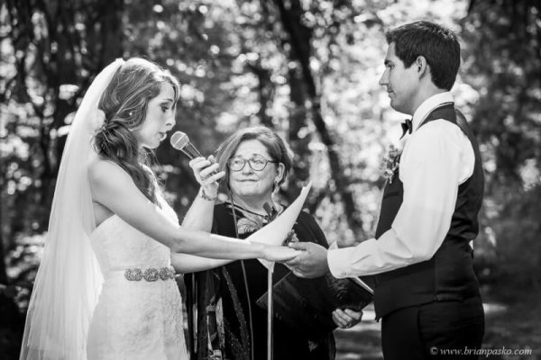 Portrait of bride saying vows at an outdoor wedding picture at Eagle Fern Park in Oregon.