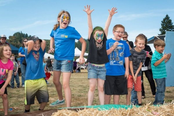 Editorial event photograph of children attaching candy in hay picture at Celebration in Boring, Oregon.
