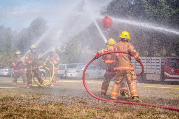 Editorial event photograph of firefighters with fire hose playing water ball training game picture at Celebration in Boring, Oregon.