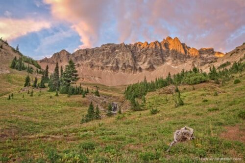 Picture of last light on mountains. meadow, and clouds at sunset in the Goat Rocks Wilderness Area, Washington.