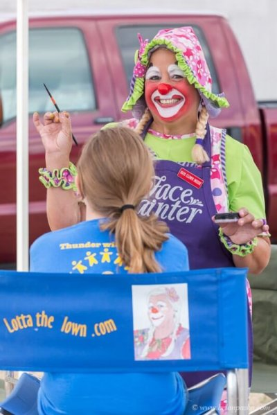 Editorial event photograph of Lotta the Cloud face painting a girl with picture at Celebration in Boring, Oregon.