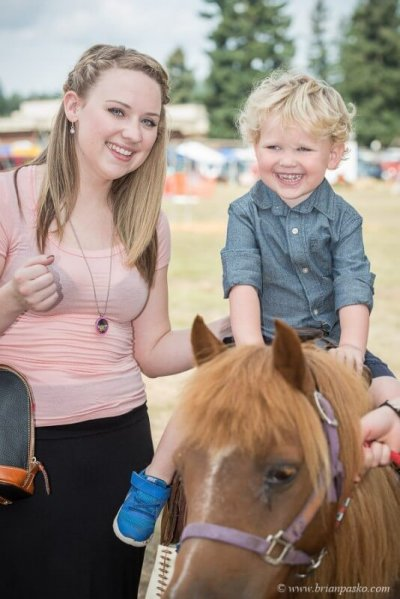 Editorial event photograph of small boy and mom riding a pony picture at Celebration in Boring, Oregon.