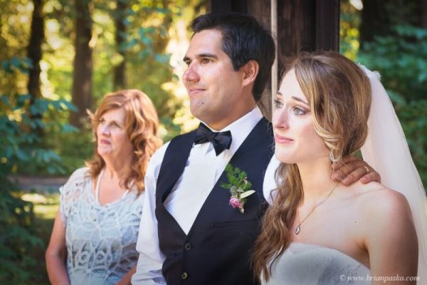 Portrait of Bride and Groom and tears picture with mom during toast at wedding in Eagle Fern Park in Oregon.