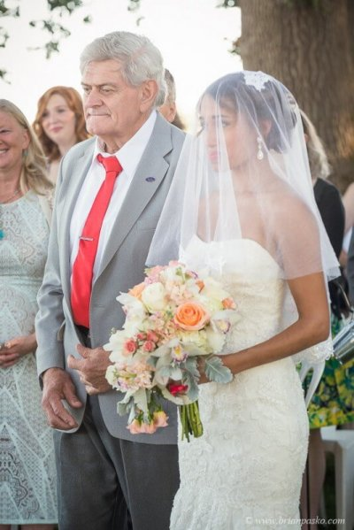 Photojournalistic portrait of father giving away beautiful bride picture at Postalwaits country wedding venue in Canby Oregon.