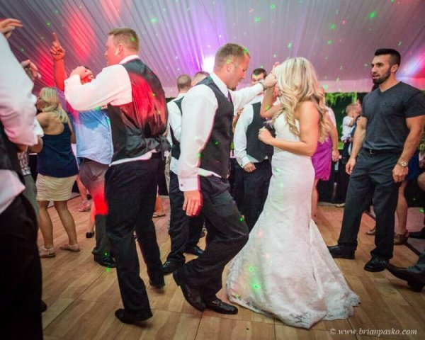 Portrait of bride and groom dancing at reception of wedding at Camas Meadows Golf Club in Washington.