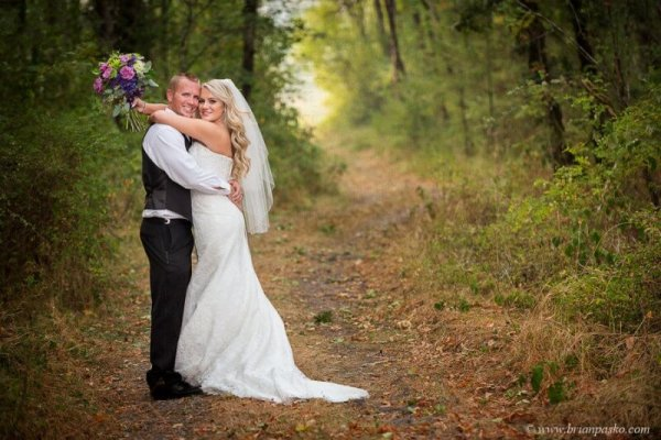 Portrait of beautiful bride and groom with bouquet on hiking trail picture of wedding at Camas Meadows Golf Club in Washington.
