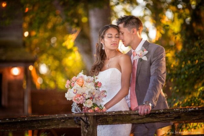 Portrait of Bride and Groom in romantic warm sunset light beautiful picture at Postalwaits country wedding venue in Canby Oregon.