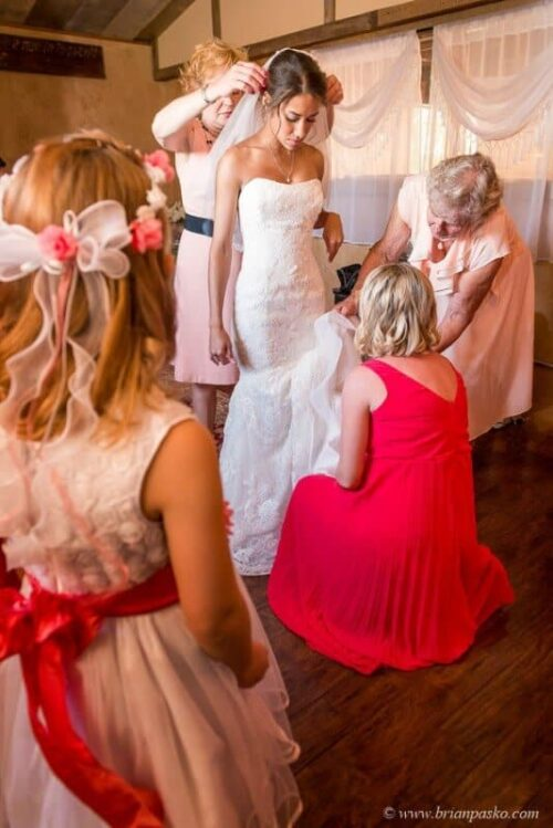 Portrait of beautiful bride getting ready surrounded by family and bridesmaids picture at Postalwaits country wedding venue in Canby Oregon.