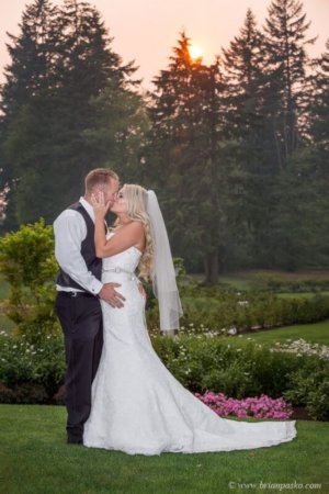 Portrait of bride kissing groom with romatnic sunset picture of wedding at Camas Meadows Golf Club in Washington.
