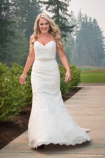 Portrait of of Bride walking on a sidewalk picture of wedding at Camas Meadows Golf Club in Washington.