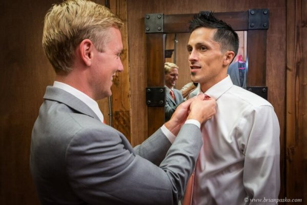 Portrait of groom and groomsman getting ready at Postalwaits country wedding venue in Canby Oregon.