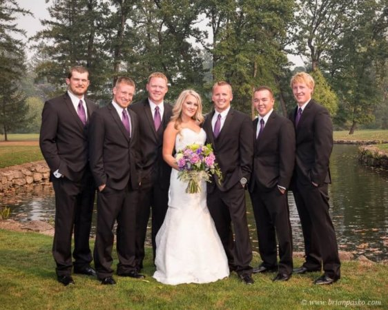 Portrait of Bride and Groomsmen by lake picture of wedding at Camas Meadows Golf Club in Washington.
