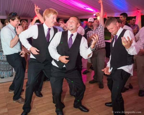 Portrait of groom and groomsmen dancing at reception of wedding at Camas Meadows Golf Club in Washington.