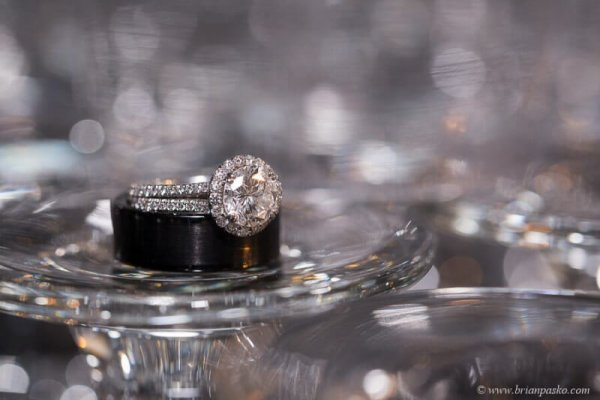 Picture of beautiful wedding rings on sparkling glass at reception at Camas Meadows Golf Club in Washington.
