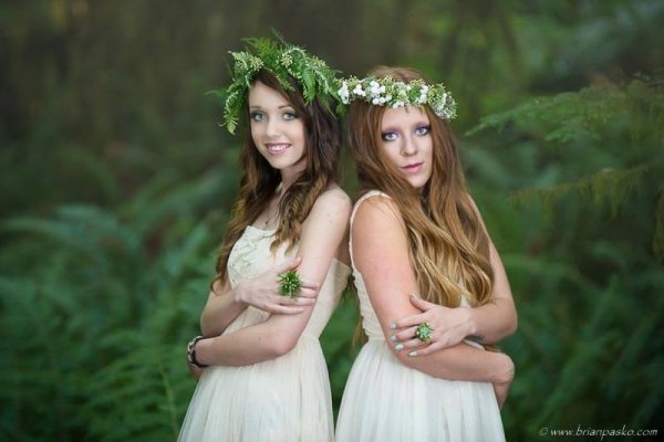 Fashion portrait of two forest nymphs picture in Oregon forest with floral rings and crowns.