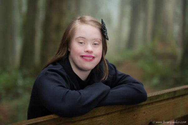 Portrait of a beautiful Estacada High School senior with special needs picture in forest.