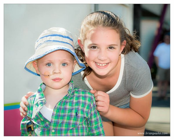 Boy with cancer with hsi friend who is a girl in remission from cancer.