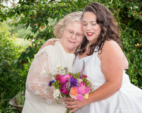Portrait of a bride hugging her mother before a wedding in McMinnville, Oregon.