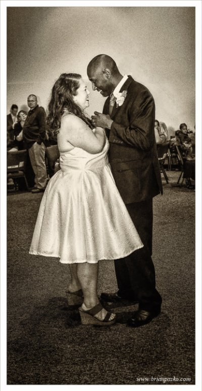 Black and white portait of a bride and groom during their first dance at a wedding in McMinnville, Oregon.