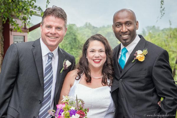 Portrait of Bride and Groom with wedding officiant before a Mcminnville wedding.