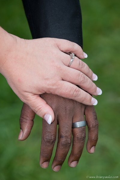 Picture of hands of bride and groom with wedding rings at a McMinnville wedding.