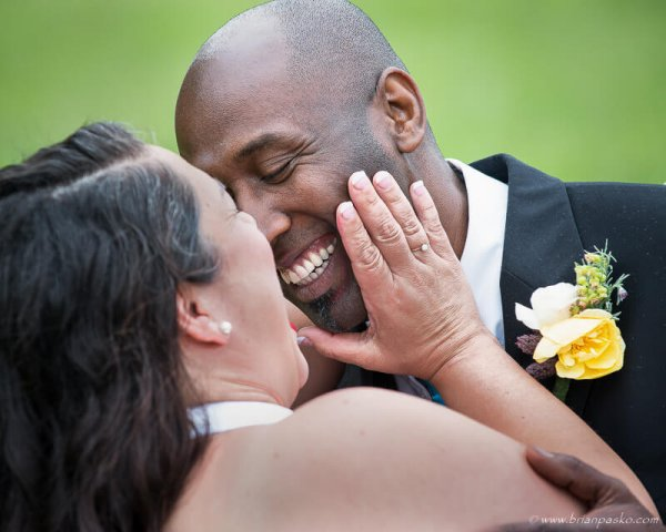 Portrait of a Groom about to kiss his Bride after McMinnville wedding.