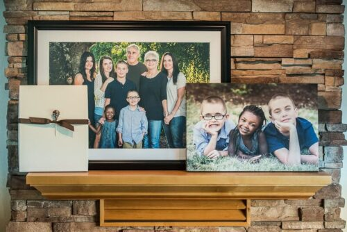 Images of family portraits printed on canvas and framed ready for hanging above a fireplace or to decorate a wall in a family home.