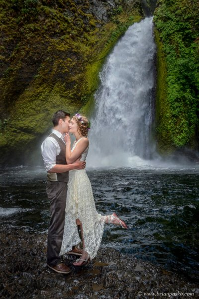 Intimate kiss between Bride and Groom at Wahclella Waterfall in the Columbia River Gorge.
